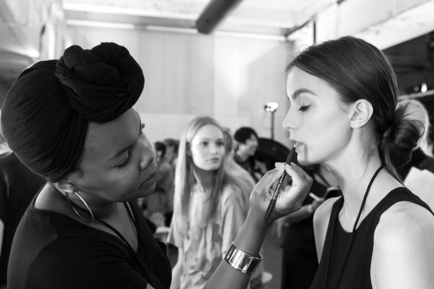 New York, NY - September 10, 2015: A model prepares backstage for the Desigual fashion show during the Spring Summer 2016 New York Fashion Week at The Arc - Skylight Moynihan Station
